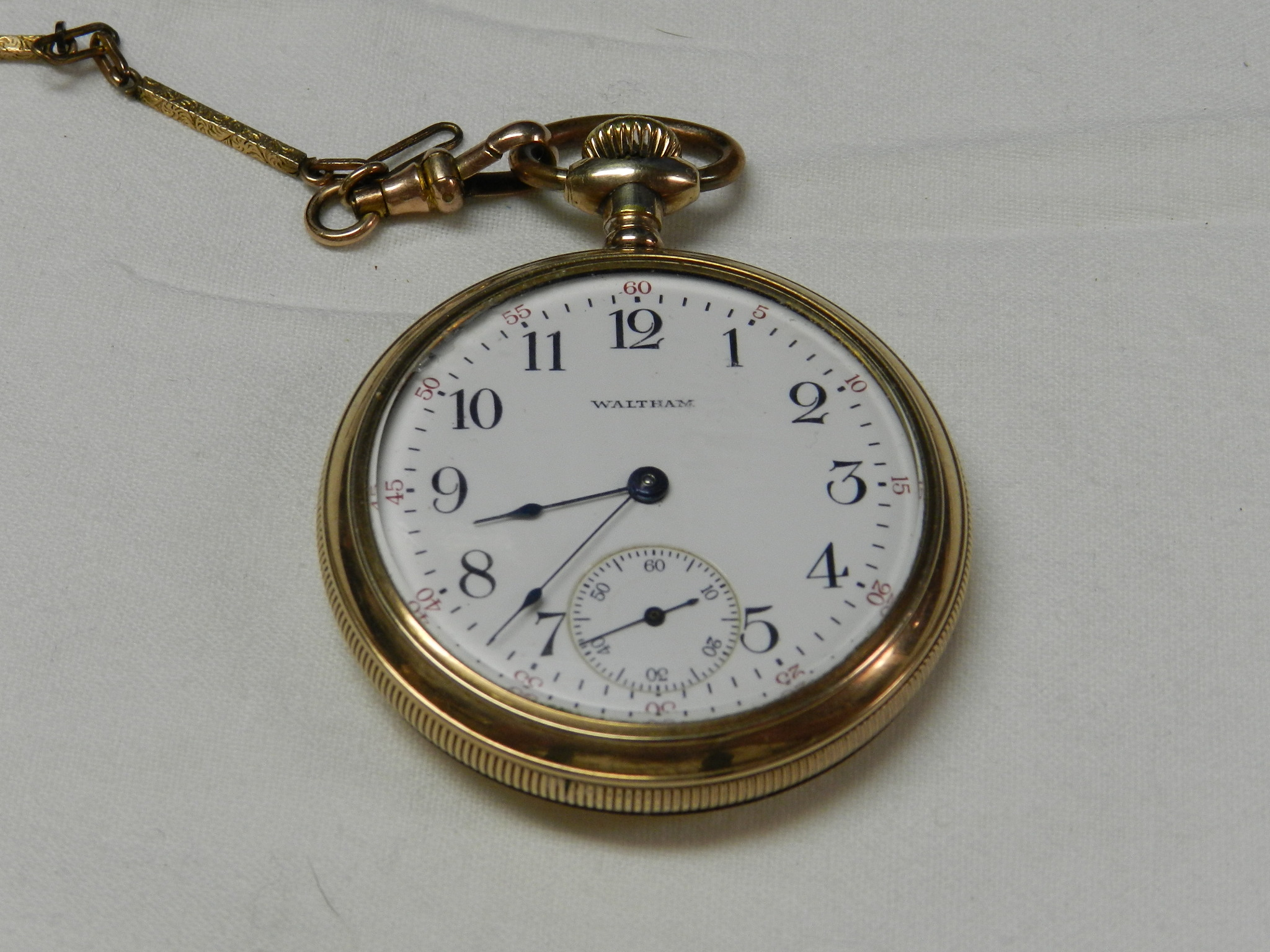 $210 - Waltham Traveller Pocket Watch - GOLD Fill and Art Relief